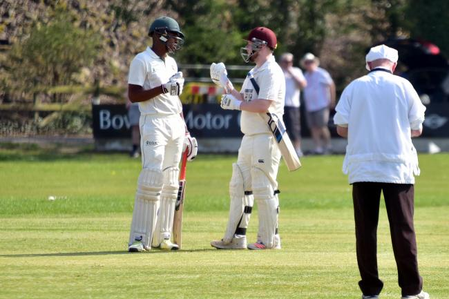 Cherry Tree CC batters Timycen Maruma and Jack Kennedy chat during their match at Whalley CC.