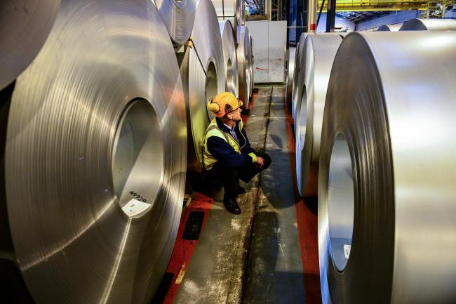 Embargoed to 0001 Monday May 20..File photo dated 15/02/17 of a worker inspecting rolls of steel. New report by City & Guilds Group suggests that a new independent body should be created to oversee the development of skills and education policy in the