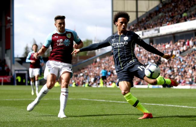 Manchester City's Leroy Sane (right) and Burnley's Charlie Taylor battle for the ball during the Premier League match at Turf Moor, Burnley..