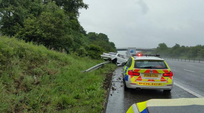 Police have issued a warning about driving in wet weather conditions after a car hit the central reservation of the m65 and landed up an embankment on the hard shoulder
