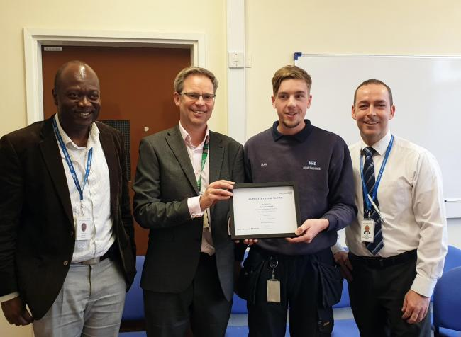 Sean Greenwood was awarded employee of the month after he tackled a major flood at Clitheroe Community Hospital. Director of service improvement, Martin Hodgson presents Sean with his East Lancs 'employee of the month' certificate, with colleagues