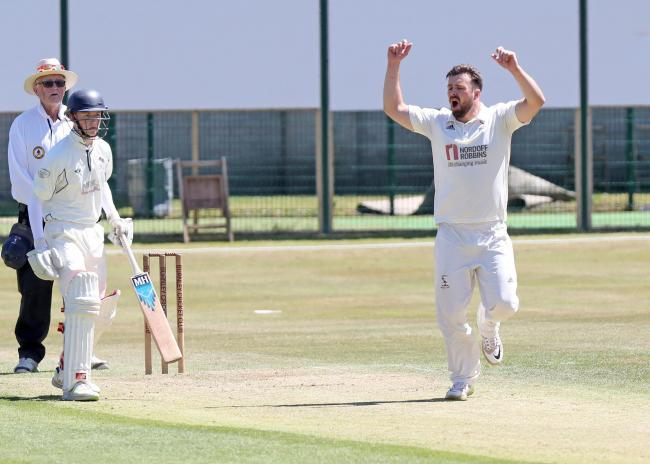 Joe McCluskie took two early wickets to help Burnley beat previous leaders Norden to go to the top of Lancashire League Division One
