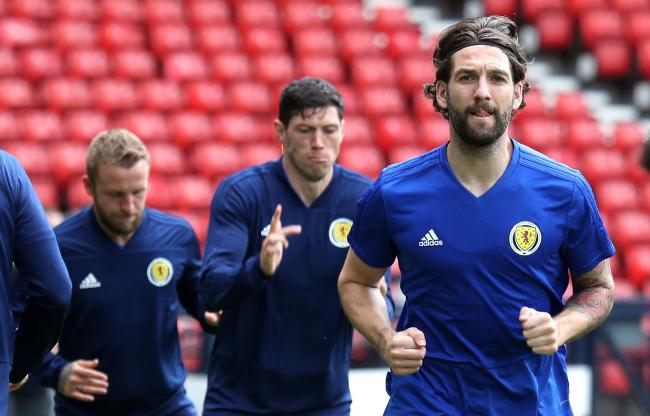 Charlie Mulgrew in action for Scotland