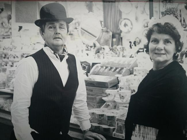Edith and Alan Metcalfe stand next to their stall at Burnley Market in 1982